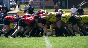 The Nashville Stone Lions (yellow) fight for possession in a scrum during their match against Knoxville.